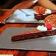 Wedge of Chocolate Valrhona Flourless Cake with Hazelnut Nougatine and Creme Fraiche