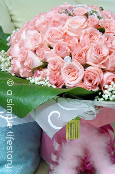 99 roses hand bouquet