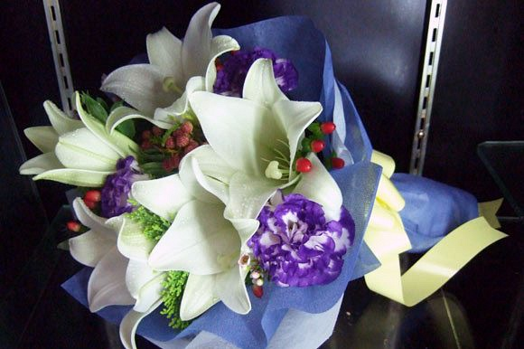Sincerely Yours - White Lilies from $38 (as shown 5 stlks Lilies @55)