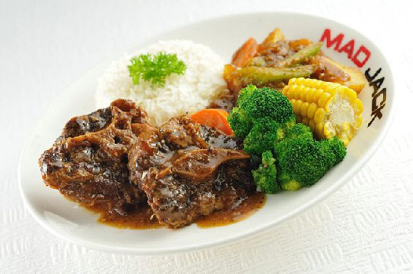 Oxtail Stew & Rice @ $14.90 Seasoned with herb & spices. Pressure-cooked to perfect tenderness. Smooth & tender ligament provides the extra ohmms. Served with vegetables.