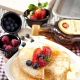 Eggs pancakes with mixed berries